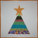 Christmas in July 2011 - Scrappy String Christmas Tree Table Topper designed by BOMquilts.com